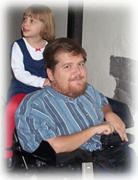 Daughter rides on back of dad's wheelchair